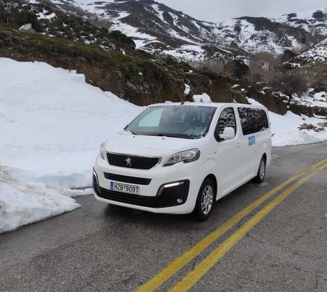 taxi minivan to omalos with snow